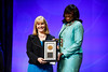 Julie Vose, MD, MBA, FASCO, ASCO Past President, presenting Olufunmilayo Olopade, MBBS, FACP, FASCO, with the Humanitarian Award during Opening Session