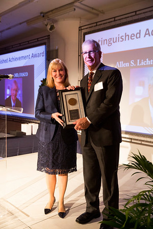 Julie Vose, MD, MBA, FASCO, presenting Allen Lichter, MD, FASCO, with the Distinguished Achievement Award during President's Dinner
