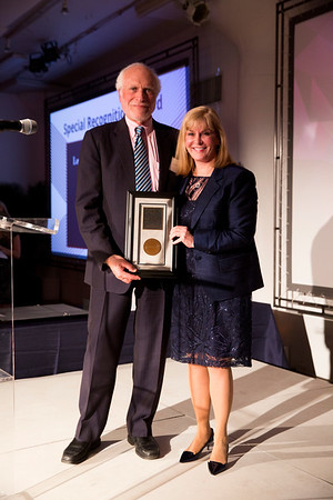 Julie Vose, MD, MBA, FASCO, presenting Lowell Schnipper, MD, FASCO, with the Special Recognition Award during President's Dinner