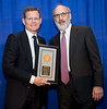 Clifford Hudis, MD, FACP, FASCO, presenting the Pediatric Oncology Award to Michael Link, MD, FASCO, during Pediatric Oncology Award and Lecture and Presentation of the Partners in Progress Award