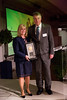Julie Vose, MD, MBA, FASCO, presenting Ross Donehower, MD, FASCO, with the Excellence in Teaching Award during President's Dinner