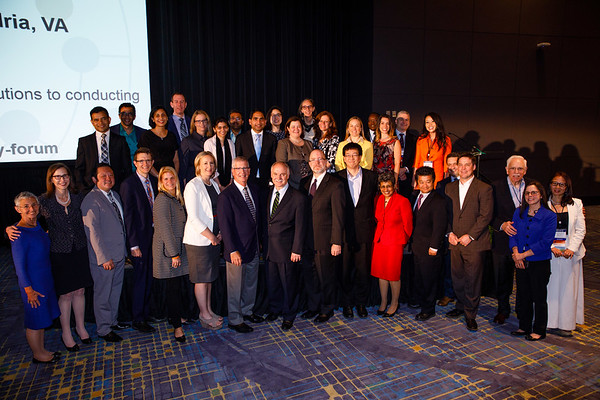 Photo of Allen S. Lichter, MD, FASCO, and Patrick Loehrer, MD, FASCO, onstage with Leadership Development Participants during Allen S. Lichter Visionary Leader Award and Lecture