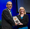 Julie Vose, MD, MBA, FASCO, presenting the Gianni Bonadonna Award to Eric Winer, MD, FASCO, during Gianni Bonadonna Breast Cancer Award and Lecture