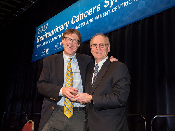 Charles G. Drake, MD, PhD, receiving keynote award from William L. Dahut, MD