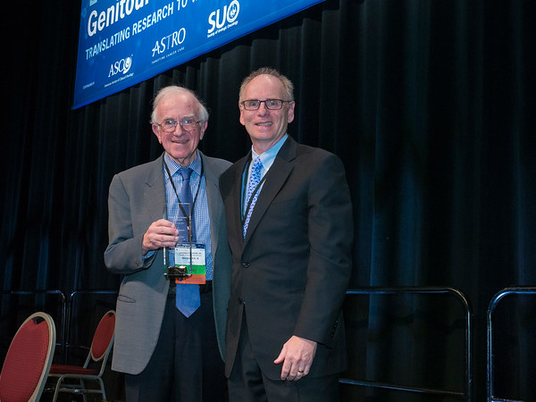 Lawrence H. Einhorn, MD, FASCO, receiving keynote award from Robert S. DiPaola, MD