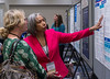 Attendees chat during the poster session