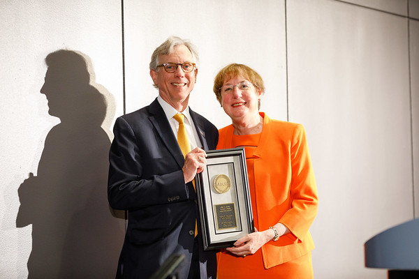 Daniel F. Hayes, MD, FACP, FASCO, presenting the Allen S. Lichter Visionary Leader Award to Nancy E. Davidson, MD, FASCO, during Allen S. Lichter Visionary Leader Award and Lecture