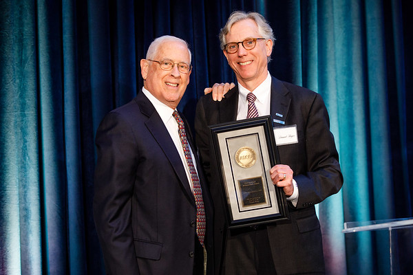 Daniel F. Hayes, MD, FACP, FASCO, presenting John Mendelsohn, MD, with the Distinguished Achievement Award during President's Dinner