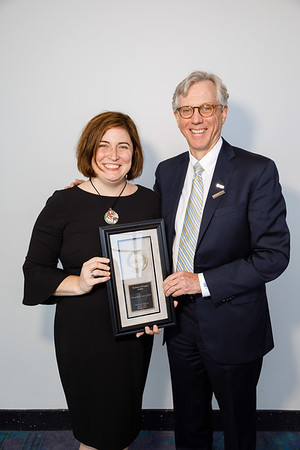 Daniel F. Hayes, MD, FACP, FASCO, presenting the Partners in Progress Award to Danielle Leach, MPA, during Pediatric Oncology Award and Lecture and Presentation of the Partners in Progress Award