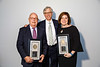 Daniel F. Hayes, MD, FACP, FASCO, presenting Partners in Progress Award winner Danielle Leach, MPA, and Gregory H. Reaman, MD, FASCO, during Pediatric Oncology Award and Lecture and Presentation of the Partners in Progress Award