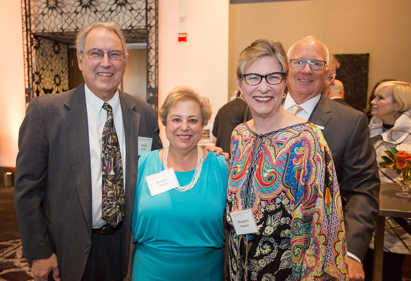 David and Bonnie Colcher and Drs. Margaret and Richard Tempero  mingling at the cocktail reception during 2018 Conquer Cancer Foundation Dinner