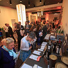 Event attendees participating in the silent auction during 2018 Conquer Cancer Foundation Dinner