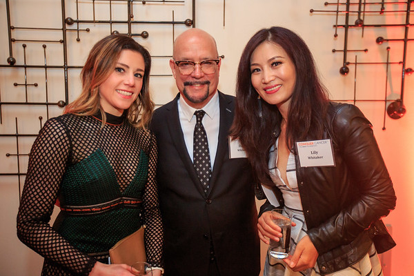 Kara Bachman, David Whitaker and Lily Whitaker mingling at the cocktail reception during 2018 Conquer Cancer Foundation Dinner