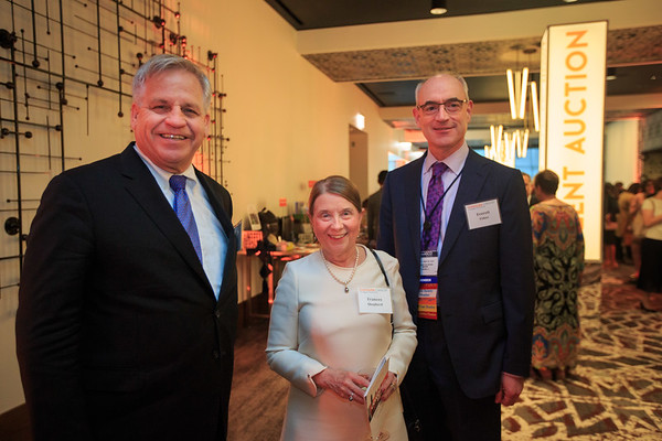 Drs. Bruce Johnson, Frances Shepherd and Everett Vokes mingling at the cocktail reception during 2018 Conquer Cancer Foundation Dinner