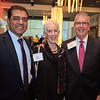 Yatin Mundkur, Evie Lichter, and Dr. Allen Lichter mingling at the cocktail reception during 2018 Conquer Cancer Foundation Dinner
