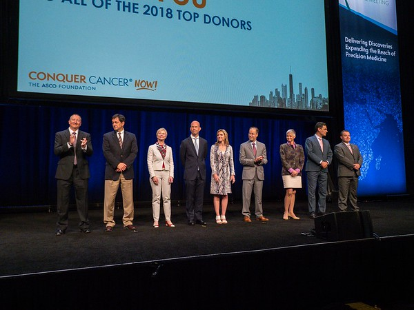 Thomas G. Roberts, Jr., MD, Nancy Daly, MS, MPH, Daniel F. Hayes, MD, FACP, FASCO, with Conquer Cancer Top Donors during Opening Session