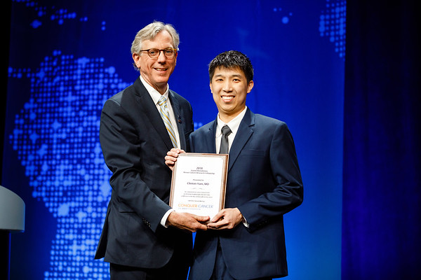 Daniel F. Hayes, MD, FACP, FASCO, presenting Gianni Bonadonna Fellowship plaque to Clinton Yam, MD, during Gianni Bonadonna Breast Cancer Award and Lecture