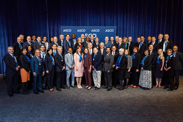 Bruce E. Johnson, MD, FASCO, Daniel F. Hayes, MD, FACP, FASCO, and Clifford Hudis, MD, FACP, FASCO, with FASCO recipients during Opening Session
