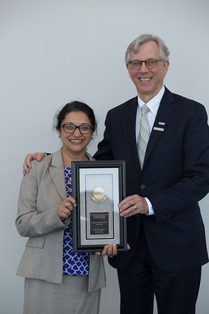 Daniel F. Hayes, MD, FACP, FASCO, presenting Supriya Gupta Mohile, MD, MS, with the B.J. Kennedy Award and Lecture for Scientific Excellence in Geriatric Oncology during B.J. Kennedy Award and Lecture for Scientific Excellence in Geriatric Oncology