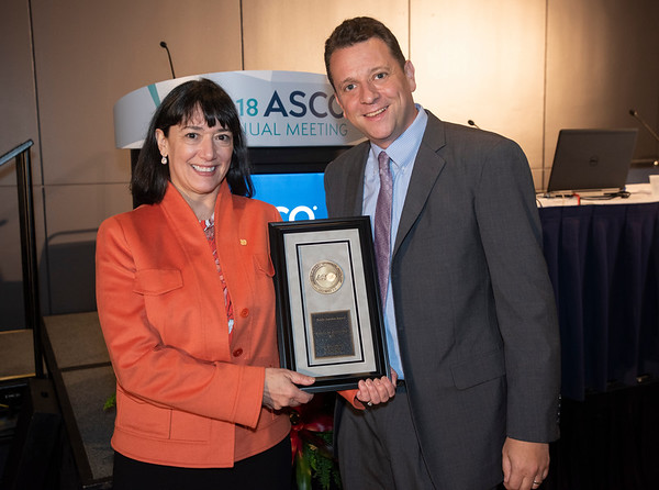 Monica Bertagnolli, MD, FASCO, presenting the Public Service Award to Gideon Blumenthal, MD, during Collecting and Using Real-World Evidence: Supplementing and Perhaps Replacing Clinical Trials