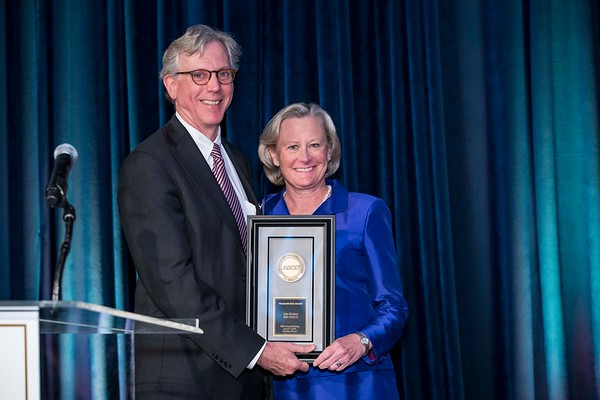 Daniel F. Hayes, MD, FACP, FASCO, presenting Julie Gralow, MD, FASCO, with the Humanitarian Award during President's Dinner