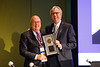Daniel F. Hayes, MD, FACP, FASCO, presenting the Pediatric Oncology Award to Gregory H. Reaman, MD, FASCO, during Pediatric Oncology Award and Lecture and Presentation of the Partners in Progress Award