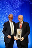 Daniel F. Hayes, MD, FACP, FASCO, presenting Gabriel Hortobagyi, MD, FACP, FASCO, with the Gianni Bonadonna Breast Cancer Award and Lecture during Gianni Bonadonna Breast Cancer Award and Lecture
