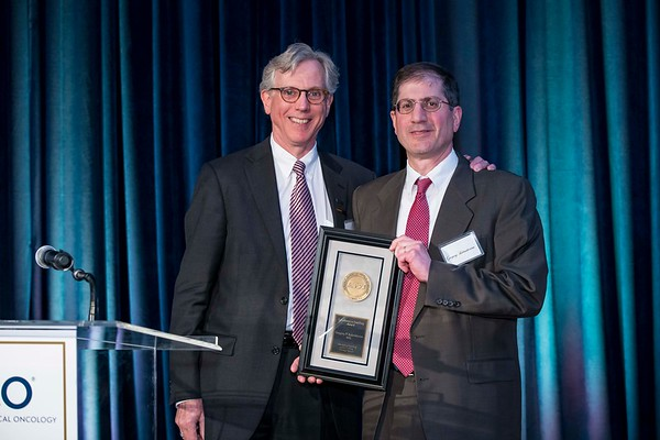 Daniel F. Hayes, MD, FACP, FASCO, presenting Gregory Kalemkerian, MD, with the Excellence in Teaching Award during President's Dinner