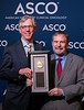 Daniel F. Hayes, MD, FACP, FASCO, presenting the Science of Oncology Award to Douglas Lowy, MD, during Plenary Session