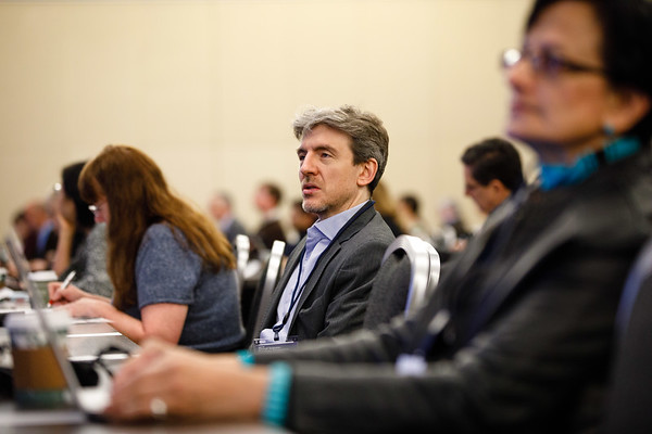 Attendees listen to a presentation at the 2018 ASCO-SITC Clinical Immuno-Oncology Symposium during the day