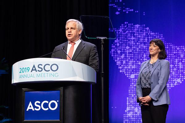Plenary Session Bruce E. Johnson, MD, FASCO, presenting the Distinguished Achievement Award to Robert Mayer, MD, FASCO