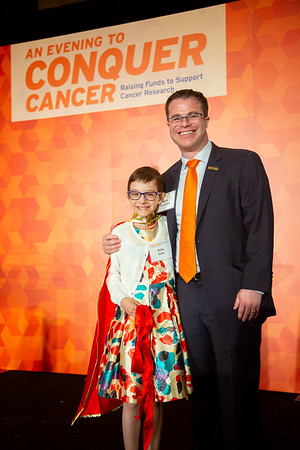 Conquer Cancer Dinner: An Evening to Conquer Cancer Cancer survivor Bella Raffin with her doctor and Conquer Cancer 2016 Young Investigator Award (YIA) recipient Mark A. Applebaum, MD