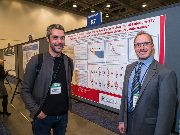 """Abstract 228, """"Results of a 50 patient single-centre phase II prospective trial of Lutetium-177 PSMA-617 theranostics in metastatic castrate-resistant prostate cancer,"""" presented by Dr. Michael Hofman, right, and John Viloet, left, during Poster Session A"""