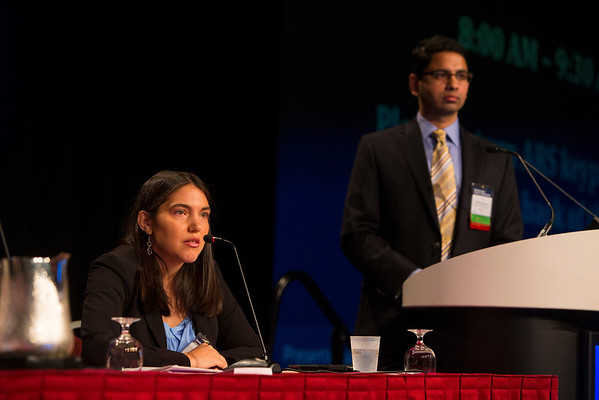 Orlando, FL - 2013 Genitourinary Cancers Symposium - Orlando, FL: Andrea B. Apolo, MD (left) and Ashish M. Kamat, MD, Co-Chair, discusses abstracts during the General Session IV: Urothelial Carcinomas: Multimodal Management of Difficult Cases (ARS) at the Genitourinary Cancers Symposium 2013 here today, Friday February 15, 2013. The Symposium is supported by ASCO, the American Society of Clinical Oncology, ASTRO, the American Society of Radiation Oncology and SUO, the Society of Urologic Oncology. Over 2,500 physicians, researchers and allied healthcare professionals are attending the meeting which is being held at the Rosen Shingle Creek in Orlando and features the latest Genitourinary Cancers research in the areas of basic and clinical science.  Date: Friday February 15, 2013.  Photo by © ASCO/Todd Buchanan 2013 Technical Questions: todd@medmeetingimages.com; Phone: 612-226-5154.