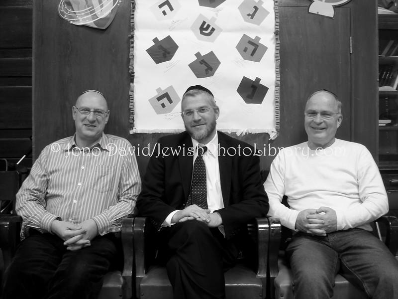 JP-D 172  Rabbi Yerachmiel Strausberg (center) and guests