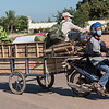 Motorcycle towing cart with cargo in Siem Reap, Cambodia