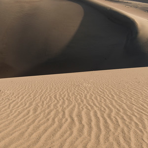 Singing sand dunes at Mingsha Shan, Gobi Desert, Dunhuang, Jiuquan, Gansu Province, China