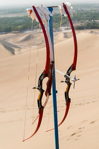 Bow and arrow on sand dune at Mingsha Shan, Dunhuang, Jiuquan, Gansu Province, China
