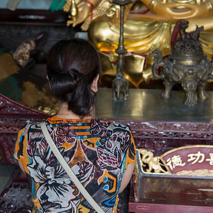 Rear view of a woman praying at the temple, Xi'an, Shaanxi, China.