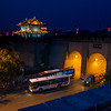 Road traffic, illuminated building in distant at Lianhu Ancient City Wall, Xi'an, Shaanxi, China.