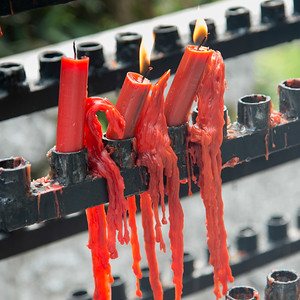 Red burning candles with melted wax at the temple, Xi'an, Shaanxi, China.