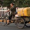 Man riding bicycle cart, Xi'an, Shaanxi, China.