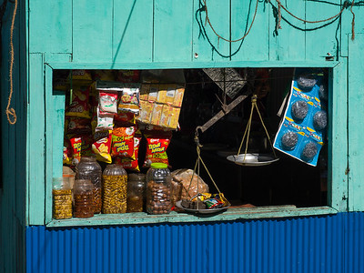 Food containers in the window of a general store, Darjeeling, West Bengal, India