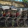Hand-pulled rickshaws parked in a row, Kolkata, West Bengal, India