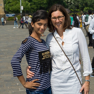 Portrait of mature women and a teenage girl smiling, Gateway of India, Colaba, Mumbai, Maharashtra, India