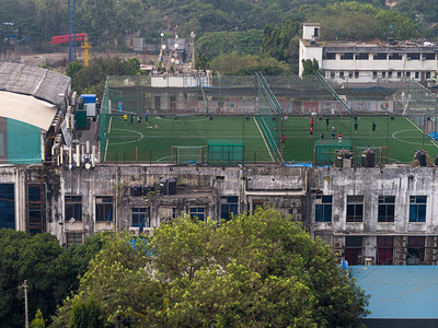 Elevated view of players practicing on sports field, Mumbai, Maharashtra, India