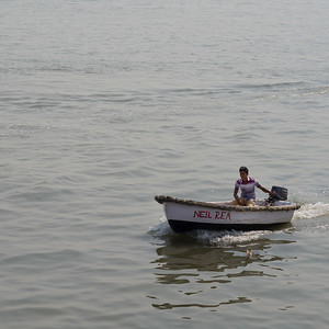 Man on a boat in the sea, near Gateway of India, Colaba, Mumbai, Maharashtra, India