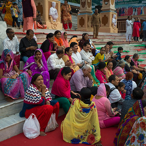 Devotees sitting on steps during Ganga Aarti, Rishikesh, Dehradun District, Uttarakhand, India