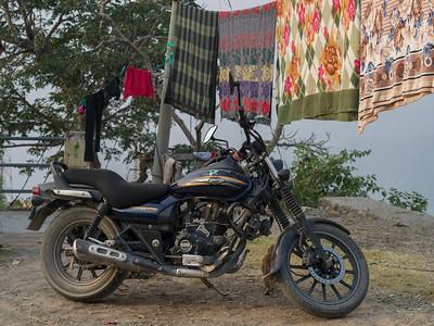Motorcycle parked near clothesline, Narendranagar, Tehri Garhwal, Uttarakhand, India