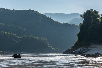 Scenic view of river with mountain range in background, River Mekong, Laos